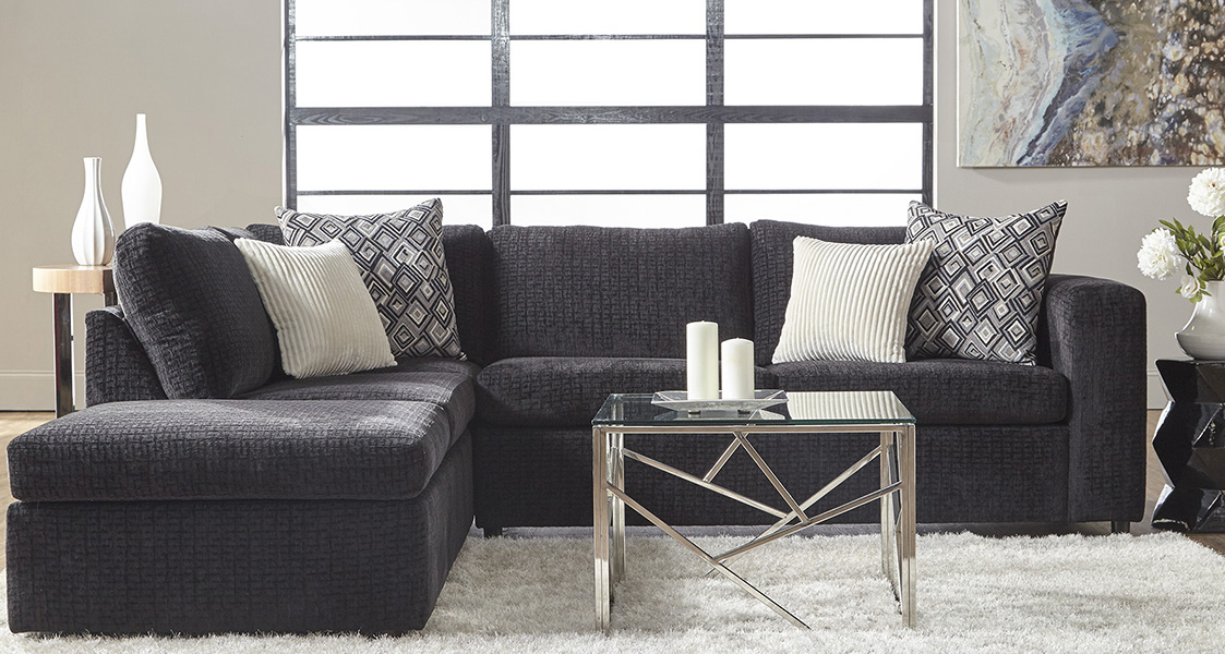 Black Sectional with White Pillows